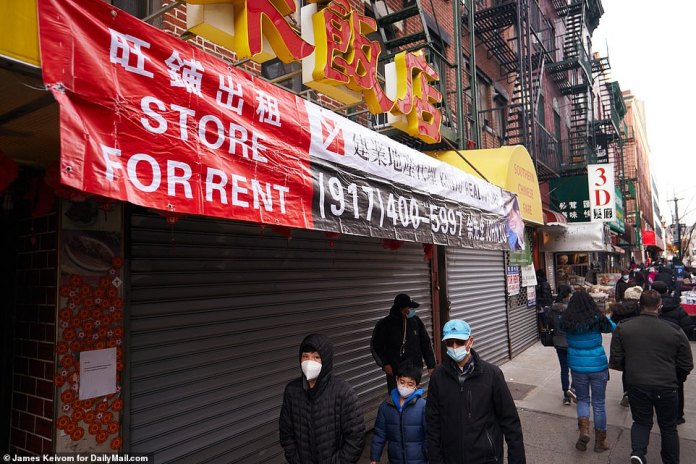 NEW YORK CITY: Photos taken by DailyMail.com over the holiday period shows the extent of the desertion in NYC's Chinatown