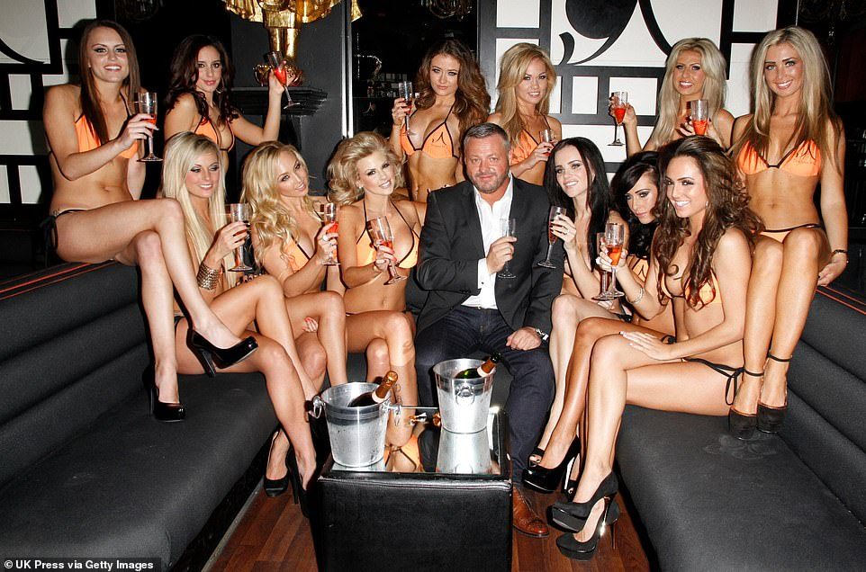 Towie Nightclub Owner Mick Norcross poses for photos alongside his new entourage in their customised 'Honeys' bikinis