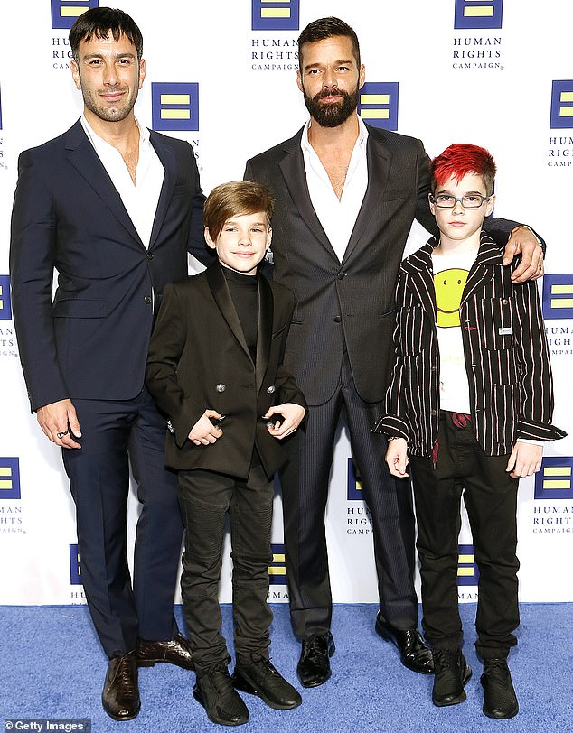 Happy family: Martin went through lockdown at his Los Angeles home with Yosef, their twin sons Valentino and Matteo, both 12, daughter Lucia, two, and son Renn, one (pictured in September 2019)