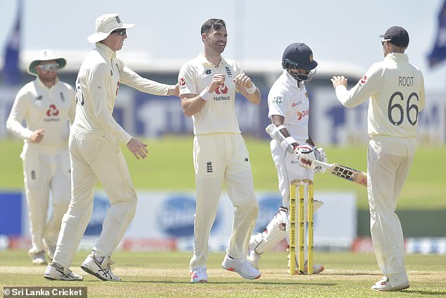 The England seamer (middle) was congratulated by team-mates for the two early wickets