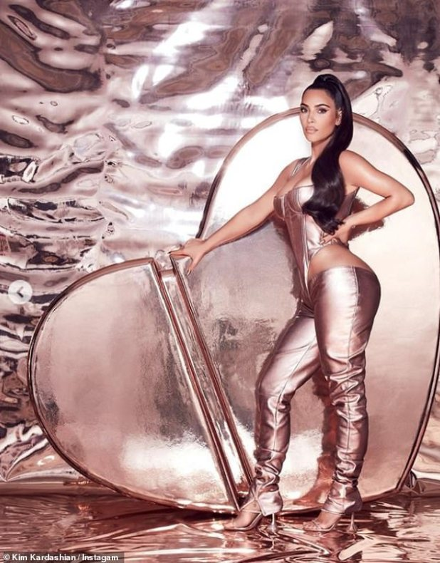 Racy: In a final image, Kim poses in a low slung trouser and a matching corset.