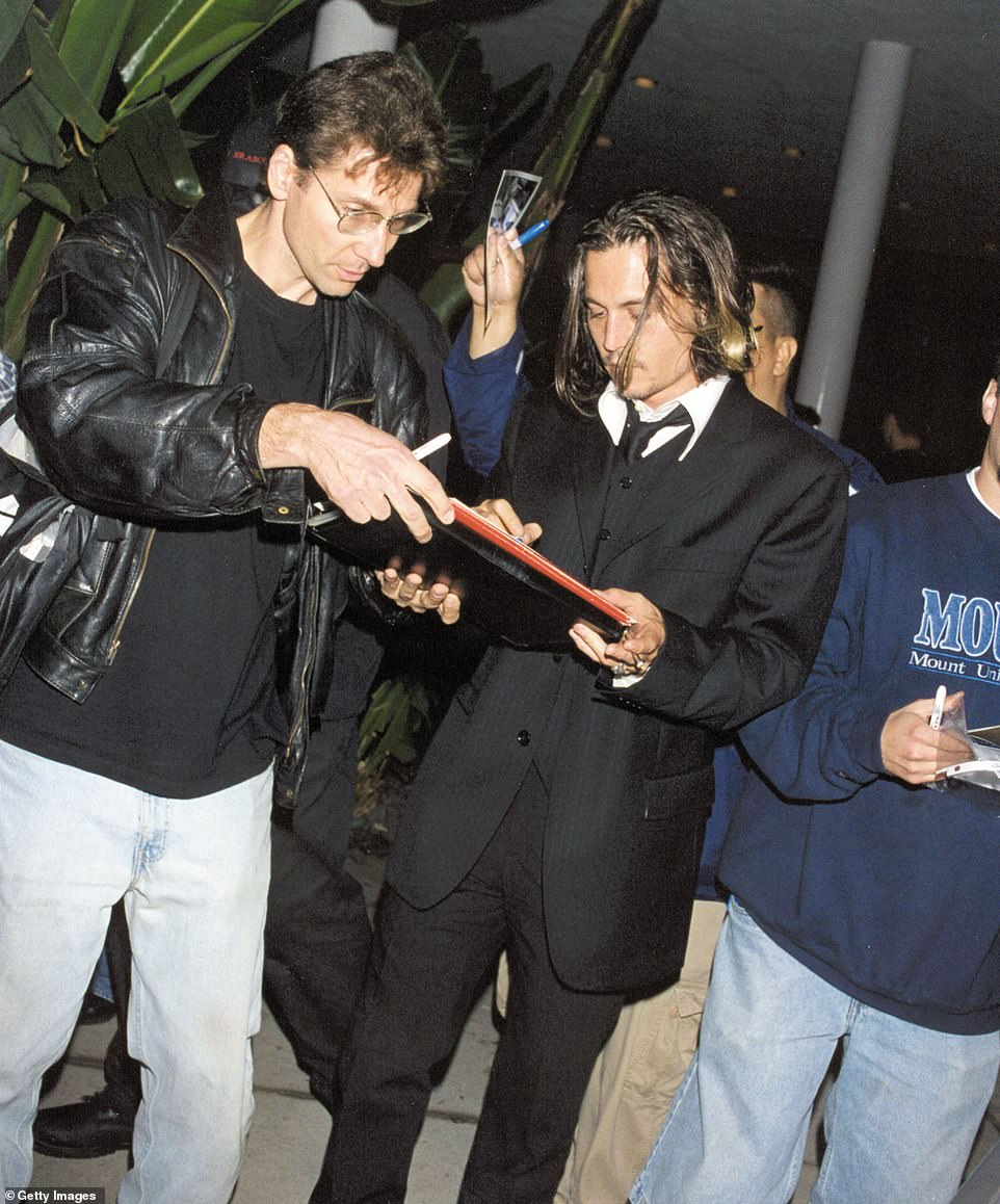 Fame!  Johnny Depp is pictured signing autographs outside the hotel in 2001