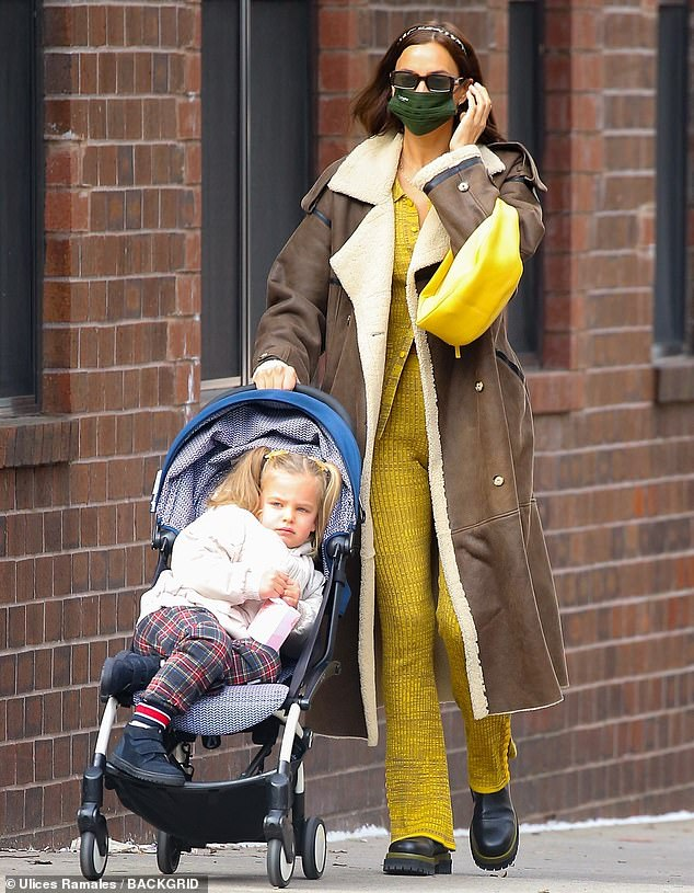 Mom time: Irina Shayk was seen wearing a stylish outfit as she took her daughter Lea for a stroll through the streets of New York on Friday morning