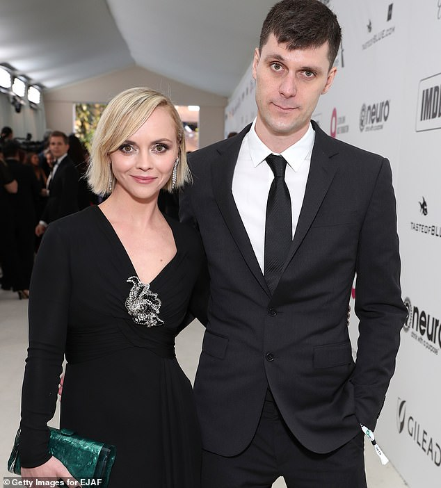 A judge has denied James Heerdegen's request for a restraining order against his wife Christina Ricci, after he claimed she is a drunk, pops pills and is a danger to their six-year-old son. The couple pictured in January 2019