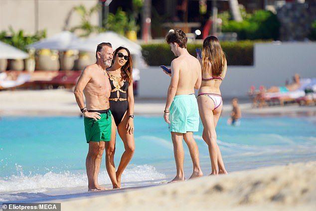 Posing: Duncan and Nigora were seen posing for photos together on the beach
