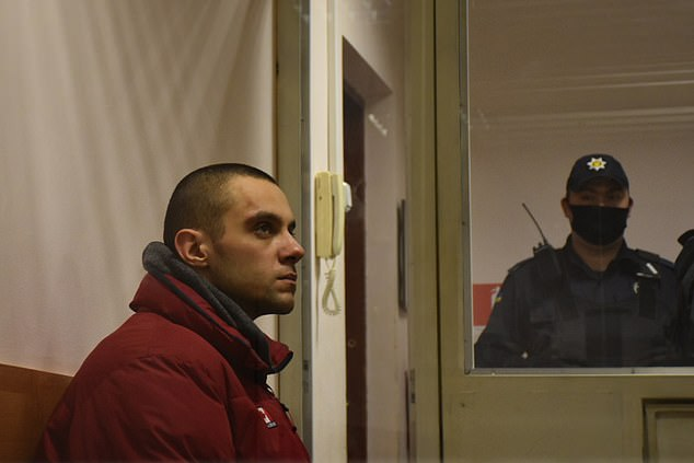 The witnesses claim they saw Dmitry Ponomarenko, 30 (pictured), leave his flat covered in blood and carrying the head of his 53-year-old father Igor Ponomarenko. Pictured:Ponomarenko in police custody after being arrested on Wednesday