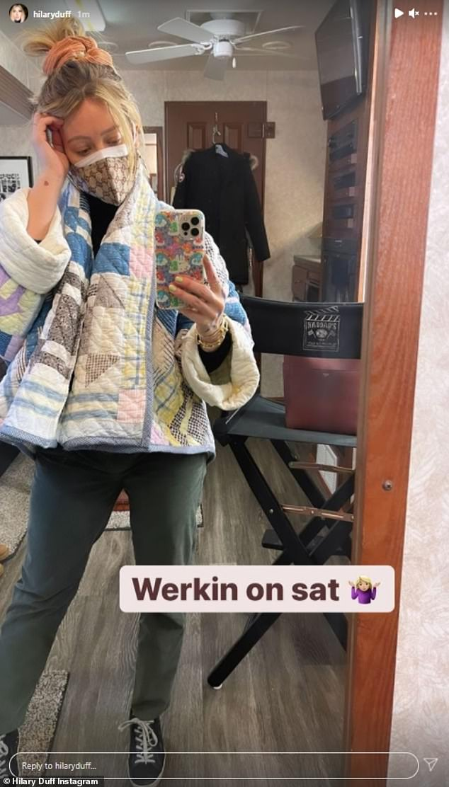 Working for the weekend: The 33-year-old later took a mirror selfie of her cozy look, rocking a reused jacket from a quilt, complete with a Gucci face mask, which she captioned: 'Werkin on sat ''