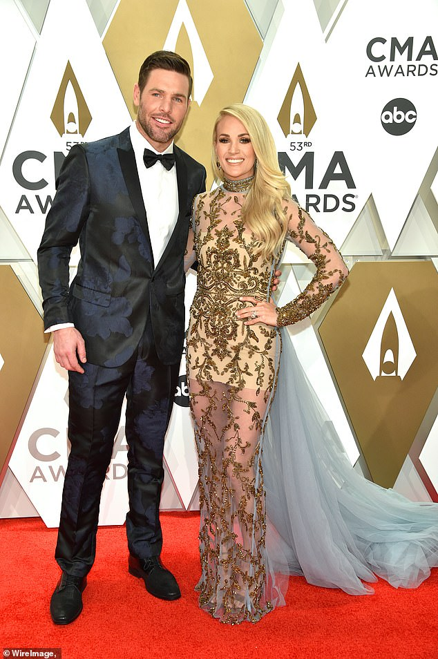"Blessing: ""Jacob, we were expecting you.  We prayed for you.  We've come a long, hard road to someday hold you back, ""Carrie said under the cliché caption;  pictured with husband Mike Fisher in 2019"