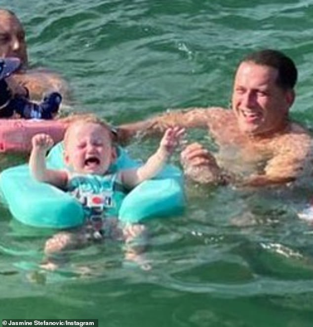 Oh my there: In the hilarious image, Harper is seen screaming hysterically from inside her inflatable float ring, while Karl simply smiles awkwardly