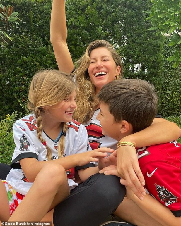 'We are already making Pappy happy here!  We love you  Gisele Bundchen, the 43-year-old six-time Super Bowl winner's wife, shared a photo of her and her daughter Vivian, 8 years old;  And son Benjamin, 11;  Show your pride in Tampa Bay Buccaneer jersey