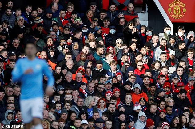 Photo shows Manchester United fans at Old Trafford during a Premier League match against Manchester City on March 8, 2020. This was United's last Premier League match before the season was suspended due to Covid