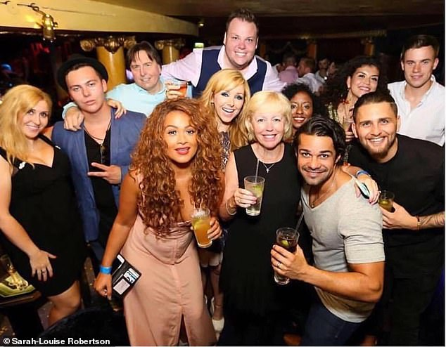 Last year, Terry (pictured back centre in a group alongside singers Zoe Birkett and Jack Jones), who was previously a radio presenter on ExmouthAiR, beat cancer