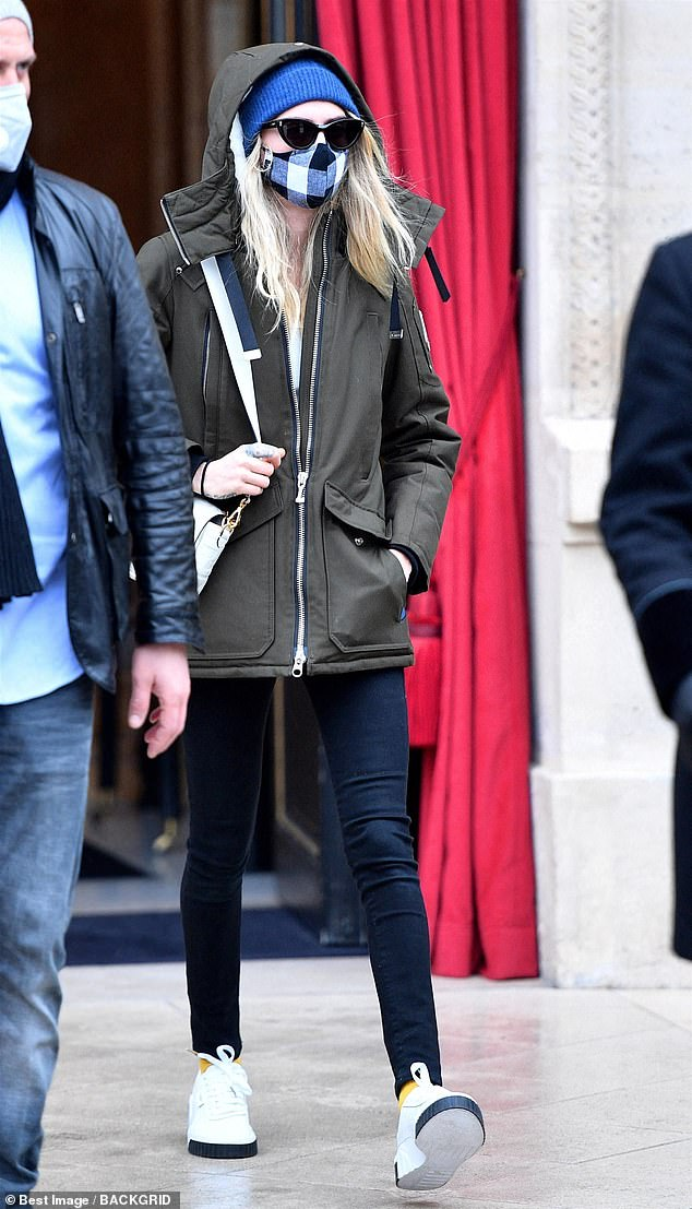 Model behavior: Cara Delevingne stayed true to her usual laid-back vibe as she left her Paris hotel on Wednesday morning as she continues to work at the city's Haute Couture Fashion Week