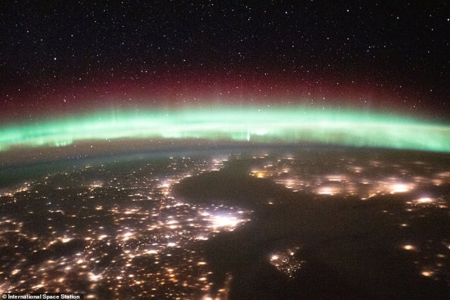 Auroras, also called 'Earth's airglow,' are caused by cosmic rays interact with gasses in the upper atmosphere, which blankets the horizon with electric colored lights. This picture was taken while the ISS was over Romania. The crew capture the auroras hanging over Sweden and Finland