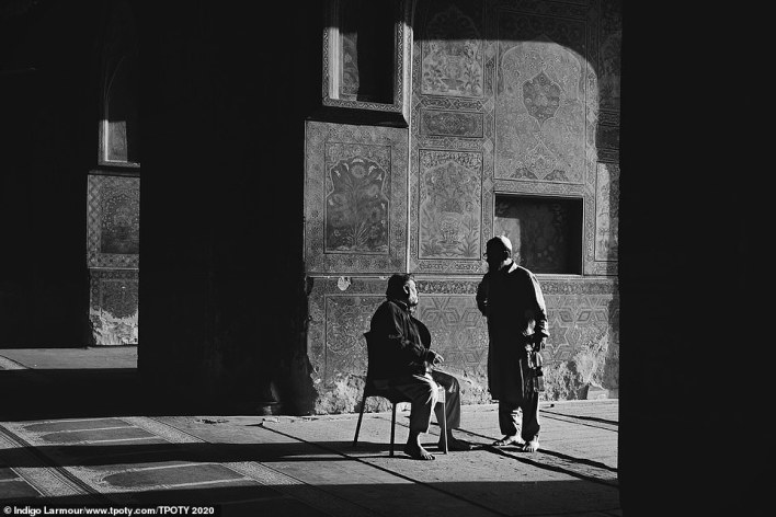 Incredibly, this beautiful image was taken by a 12-year-old - Indigo Larmour, from Ireland. It shows two worshippers chatting at the Masjid Wazir Khan mosque in Lahore, Pakistan, widely regarded to be one of the most beautiful in Pakistan