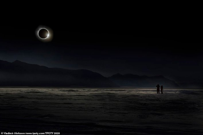 A shot Vladimir Alekseev took in Svalbard during the total solar eclipse on March 20, 2015. He said: 'It was one of the most important and impressive astronomical events. In the morning, a blizzard began, and the sky was covered with clouds. But literally an hour before the eclipse, the weather improved. And I managed to capture this amazing moment'