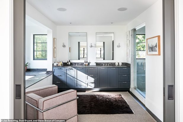 Pampered Vibes: The master bedroom features an en suite bathroom with black marble countertops and blue cabinetry