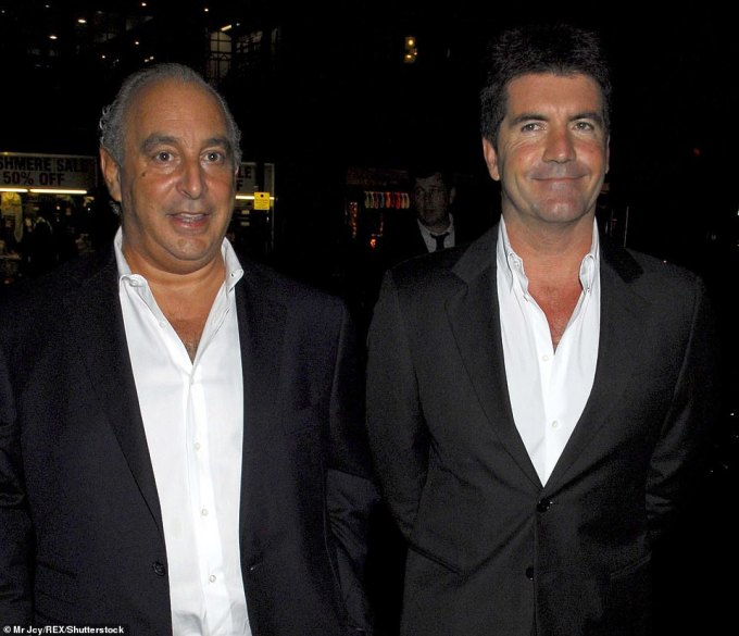 Sir Philip and Simon Cowell at a London Fashion Week party at Cafe Royal in London on September 2006