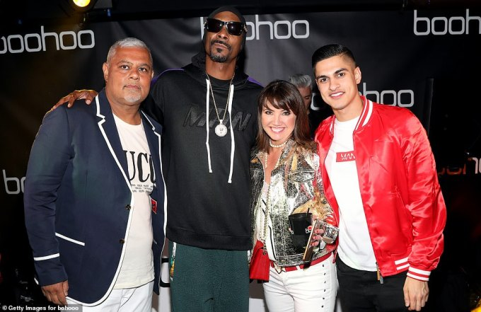 Boohoo owned by Mahmud Kamani (pictured left with Snoop Dogg, Boohoo CEO Carol Kane and his son Samir Kamani in 2018) bought Debenhams last week