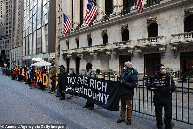 A group of demonstrators are gathered by the New York Stock Exchange building (NYSE) to protest Robinhood and bring their voices to Wall Street trades amid GameStop stock chaos