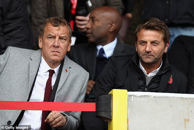 The case concerns claims that up to 50 per cent of Swindon Town chairman Lee Power¿s (left) share in the club is held in trust for Michael Standing