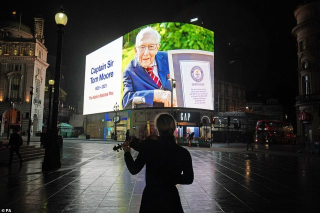 Tributes have poured in since news of Sir Captain Tom Moore's death broke yesterday. A message over a deserted Piccadilly Circus last night read: 'The Nation Salutes You,' in honour of his phenomenal life