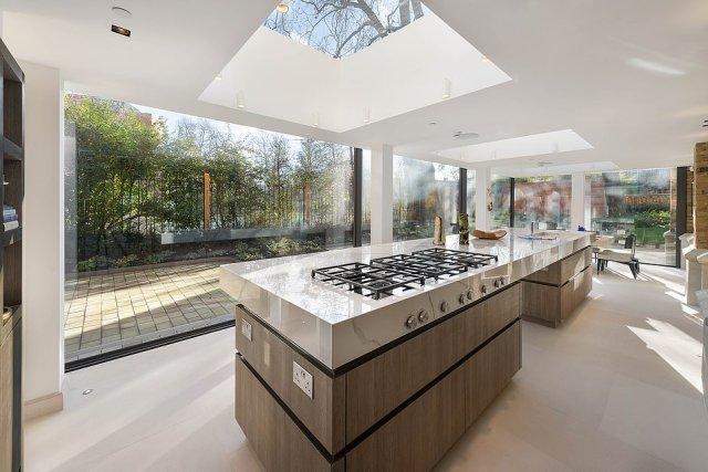 The kitchen has a double-door Gaggenau fridge-freezer, Bora cooking range and Ashford marble worktop already installed