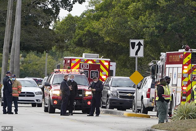 Five agents in total were shot, including the two that died.Law enforcement officers are pictured blocking an area where the shooting unfolded