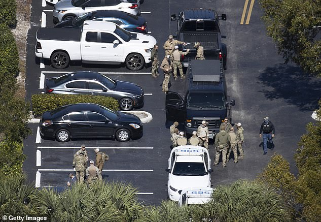 A heavy law enforcement presence remained in the vicinity of the apartment complex during the afternoon as authorities continued to investigate