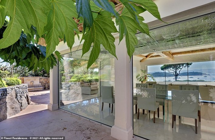 The listing says: 'Her architecture marrying tradition and modernity, the luxuriant vegetation, the freshness of the sea air and the extraordinary light give this superb luxury villa this unique feeling of quietness and serenity of early summer days on the French Riviera'