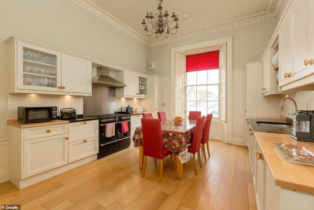 Beautifully designed: The spacious flat includes a bright kitchen with high ceilings and intricate plaster work