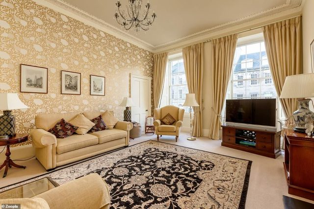 Plenty of light: The main living area in the four-bedroom flat in Edinburgh has large sash windows
