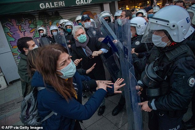 Protesters clash with riot officers during demonstrations in Istanbul on Tuesday