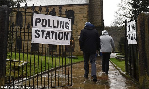 The elections, which include council, mayoral and police and crime commissioner votes, are due to take place on May 6. Pictured: Library image of residents arriving to vote at a polling station