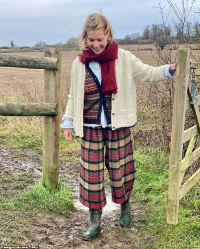 Rural retreat: Alexandra rugs up in sturdy footwear and outdoor clothes for a stroll through the nearby countryside