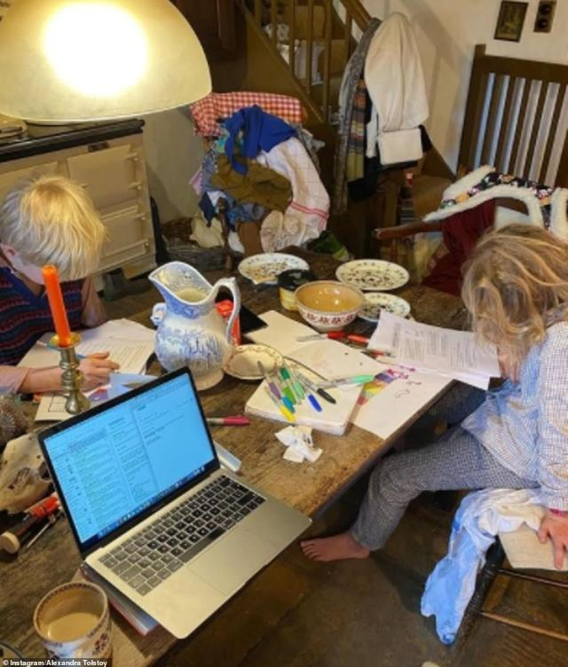 Multi-tasking: Like many parents, Alexandra is juggling her work with homeschooling her children at the kitchen table