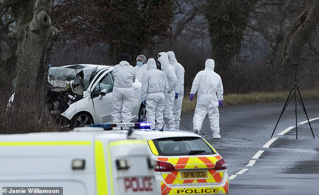 A crash then occurred on the C50 - a minor road between the B7036 and the A76 on the outskirts of Kilmarnock - at around 8.30pm. The 40-year-old male driver was pronounced dead at the scene. Pictured, police at the scene today