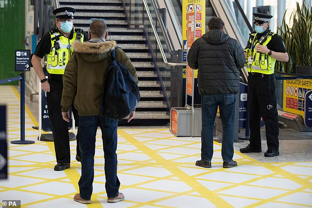 Under UK Government guidelines it is currently illegal to travel abroad for holidays and other leisure purposes. Pictured: Police stop passengers in Bristol Airport