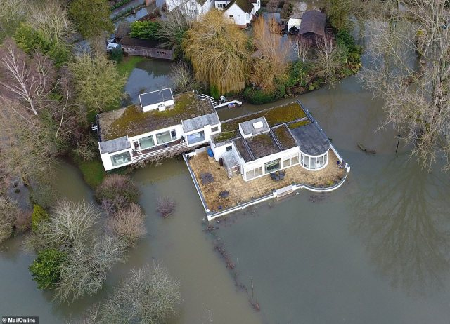 Debbie McGee's home is now dangerously close to being flooded with the garden almost completely underwater