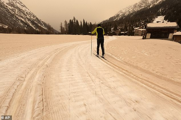 The cross-country ski track at La Fouly in Val Ferret, Switzerland, was scattered with sand from the Sahara today and left the sky an eerie shade of yellow