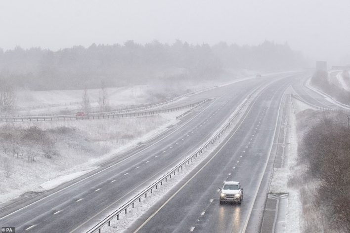 Snow falls on the A14 near Stowmarket in Suffolk, with snow set to bring disruption to South East England and East Anglia