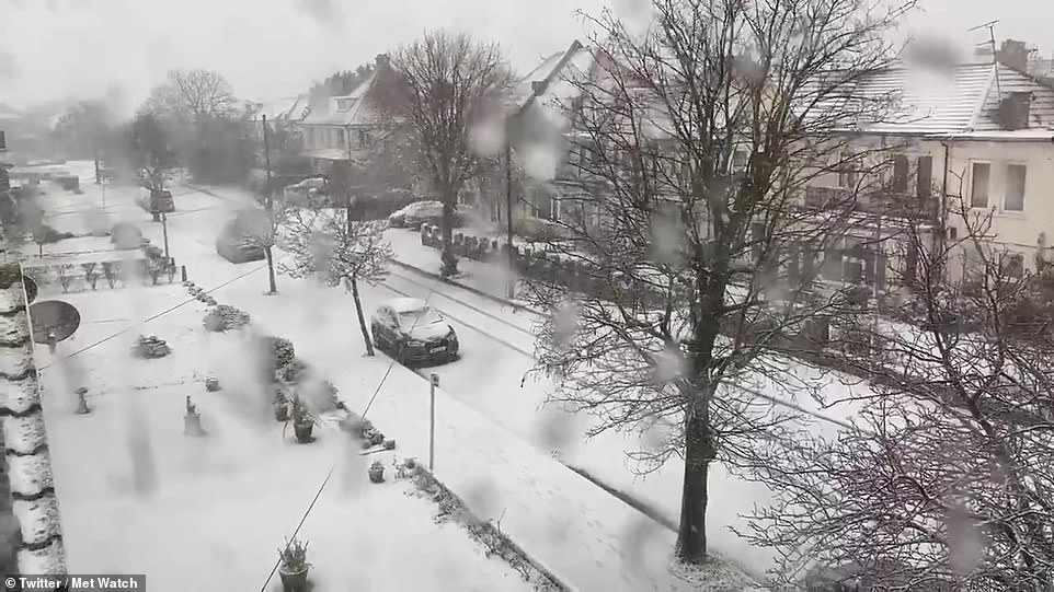 Pictured: Residents inClacton-on-Sea, Essex film videos of the snow this morning after an overnight blizzard