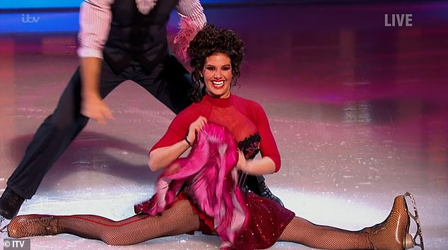 Going for it! Rebekah Vardy impressed the judges as she did the splits during a very energetic cancan routine on Sunday's Dancing On Ice