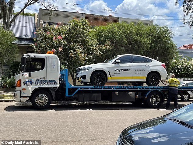 NSW Police returned to Howard's home on Tuesday to seize two cars - including a BMW with a Ray White Balmain logo - which will now be forensically examined as part of the investigation
