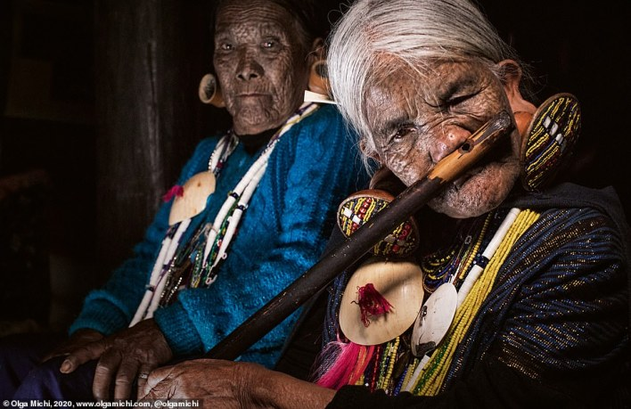 More than 100 different ethnic groups reside in Myanmar, formerly Burma, in Southeast Asia. The Chin tribes include around 1.5million people and are divided into 37 groups. Only the older women (pictured) of some Chin tribes wear these filigreed face tattoos. It is only a matter of time before this unique tradition dies out, according to Michi