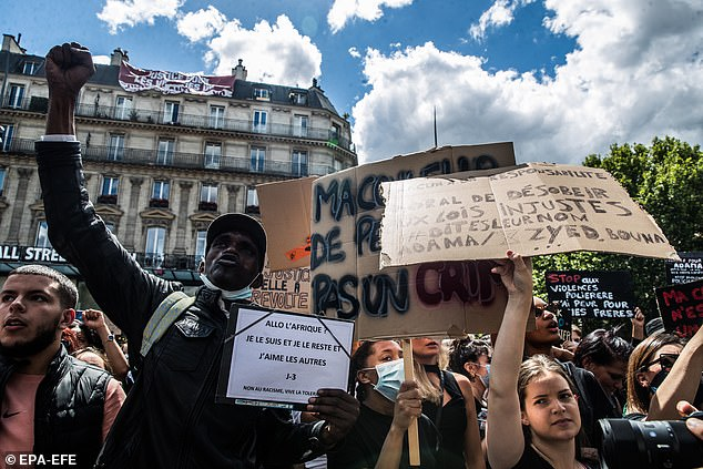 Protesters are carrying signs during a demonstration against racism and police brutality at Republique Square in Paris in June. Academics have criticized the protests in France