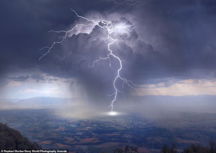 This image of a lightning-filled storm cloud was snapped by Raphael Barbar from a mountain called Salève near Geneva. He scoops the national award title for Switzerland