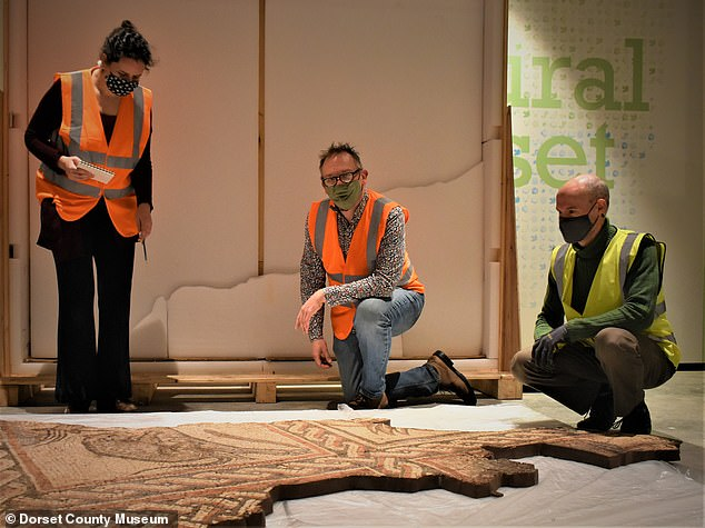 Pictured L-R: Conservator Riva Boutylkova, Director Dr Jon Murden and Museum Technician Mark Pettit assessing the mosaic after it arrived at the Dorset County Museum last week