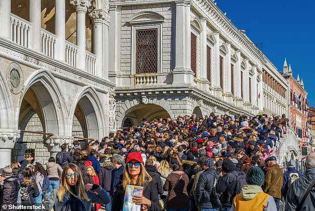 Professor Frey: 'The crowd in front of the Doge's Palace was oppressive, and I was right in the middle.' Pictured, a dense crowd packed on Ponte della Paglia, a bridge in Venice, before Doge's Palace (Palazzo Ducale)