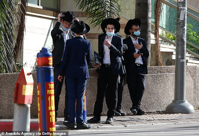 Inhabitants of 637 households in the Israeli city of Bnei Brak were tested for Covid-19 in 2020's first wave and the data was inputted into a statistical model.Previous research has found that in Israel ultra-Orthodox jews account for 12 per cent of the country's population but two-thirds of all Covid-19 infections. Pictured, ultra-orthodox Jewish men wearing masks during the third lockdown in Bnei Brak on December 31, 2020